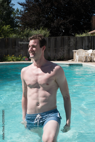 Cute Guy Getting Out Of A Swimming Pool On A Hot Day Young White