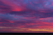 canvas print picture - Landscape with bloody sunset. The terrain in southern Europe. Tragic gloomy sky. Purple-magenta clouds.