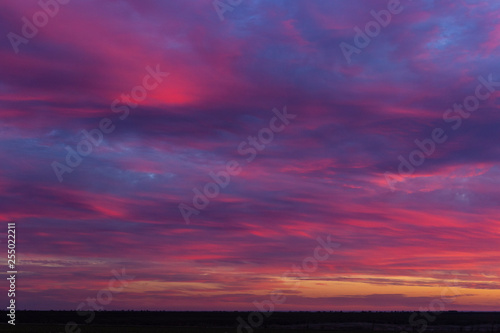 Poster Prune Landscape with bloody sunset. The terrain in southern Europe. Tragic gloomy sky. Purple-magenta clouds.