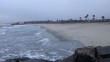 static shot of mild waves on southern california in overcast, winter weather