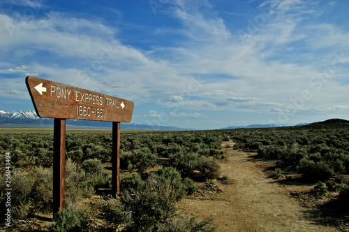 Fotografie, Obraz Pony Express Trail and marker in  sagebrush desert,  crossing Highway 50, centra