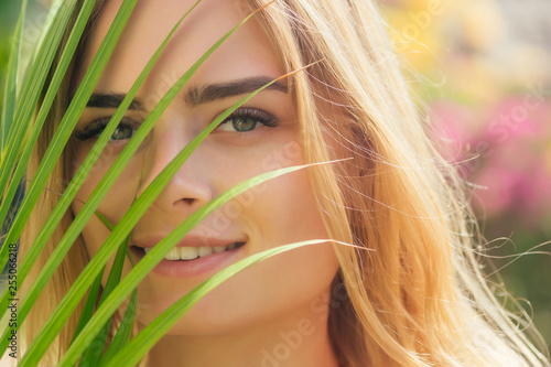 Photo  close up portrait face blond woman thick eyebrows like Cara Delevingne with palm