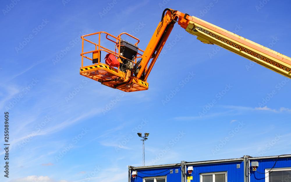 Fototapety, obrazy: Basket lift on construction site
