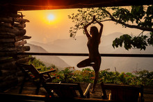 Woman In Tropical Open Yoga St...