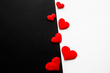 Bright Red Textile Hearts In Middle On Black And White Paper Background. Fight Between Love And Hate Concept. Relationships Difficulties. Top View. Empty Place For Text.