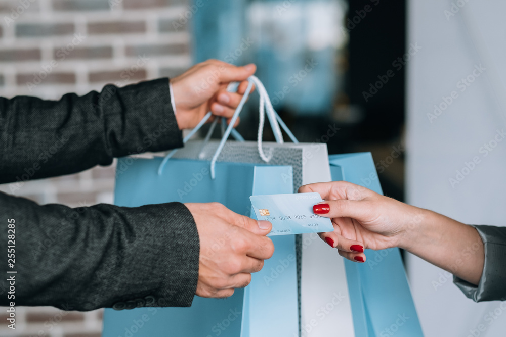Fototapeta Urban shopping payment. Female lifestyle. Woman purchasing with credit card.