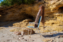 Trunk Doll On Beach Chair Simulating A Person Sunbathing