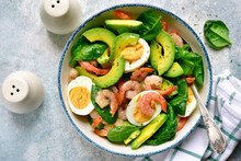 Avocado Salad With Baby Spinach, Shrimps And Boiled Eggs.Top View With Copy Space.