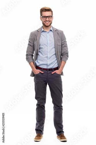 Fotografiet Full length portrait of young man standing on white background