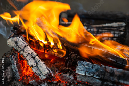 Recess Fitting Firewood texture Burning firewood. Fire, flames, charred wood
