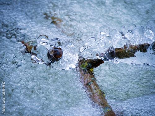 Obraz na plátně  ice, icicles in water