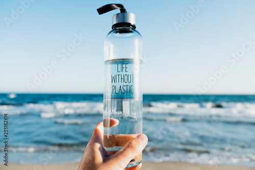 Fényképezés  water bottle with the text life without plastic