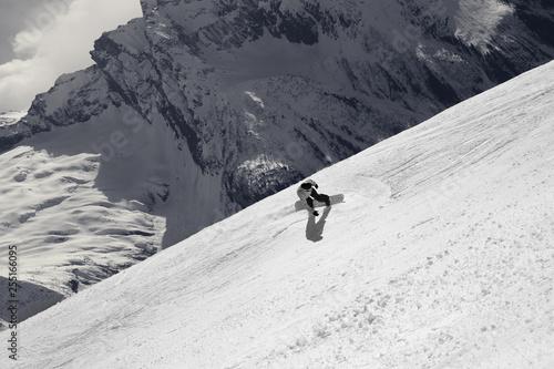 Snowboarder descends on off-piste ski slope Canvas Print