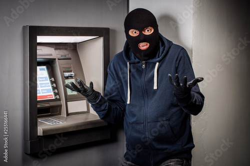 Obraz na płótnie scared thief with ATM. people and emotions concept.