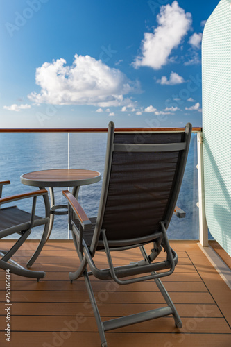 Fotografie, Obraz  Private veranda on a cruise ship overlooking the ocean with copy space