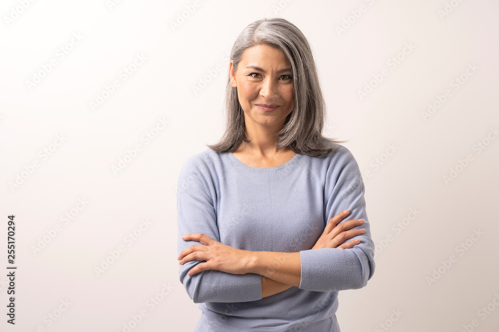 Fototapety, obrazy: Beautiful grey-haired woman with crossed arms