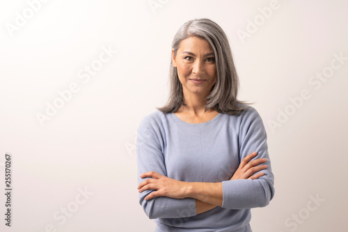 Fotografia  Mongolian Fine Gray Haired Woman on a White Background.