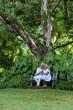 Portrait of elderly couple in tropical garden