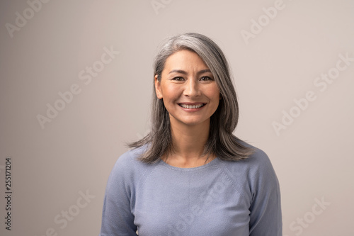 Fényképezés  Beautiful Asian woman with a stunning smile
