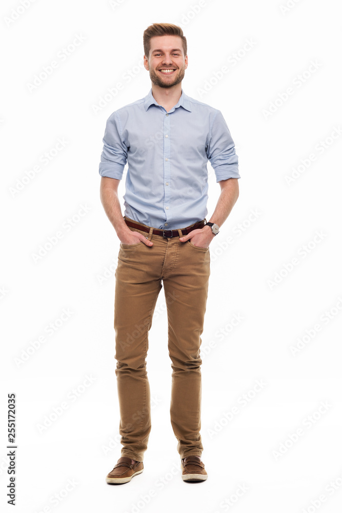 Fototapeta Full length portrait of young man standing on white background