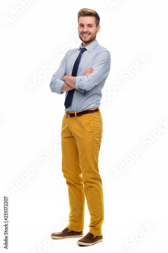 Obraz Full length portrait of young man standing on white background - fototapety do salonu