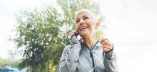 Senior Fitness Woman With Earphones