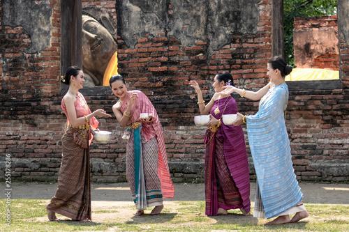Photo Stands Bali Thai girls and thai women splashing water during festival Songkran festival.