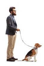 Bearded Man Standing With A Beagle Dog On A Leash