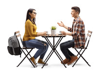 Male And Female Student Having A Coffee And Talking In A Cafe