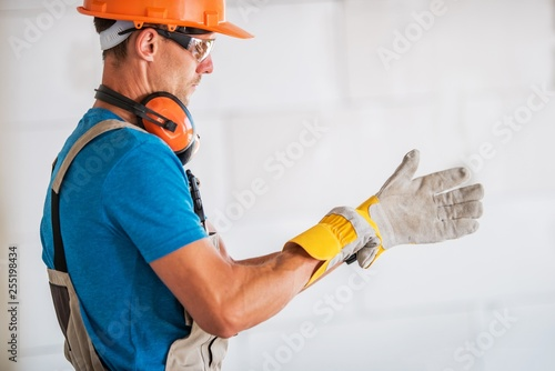 Fototapeta  Worker Wearing Safety Gloves