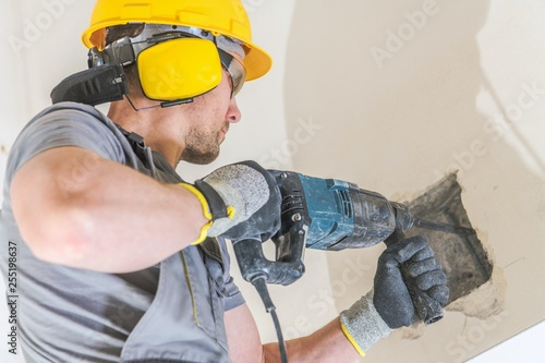 Worker with Hammer Drill