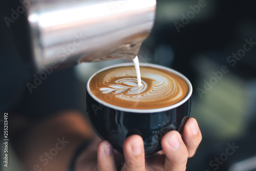 coffee latte art make by barista Poster Mural XXL