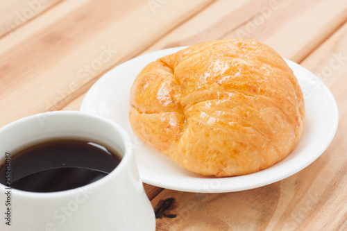 Croissant and black coffee hot morning beverage or break time  - Buy