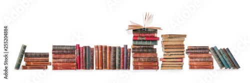 Pinturas sobre lienzo  Old books row isolated on white with clipping path