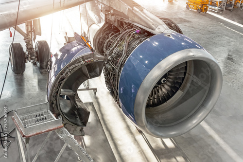 Photo Aircraft engine with open hood flaps, for service, repair.
