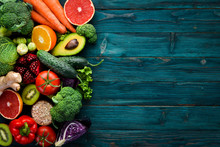 Healthy Organic Food On A Blue Wooden Background. Vegetables And Fruits. Top View. Free Copy Space.