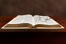 Old Bible On Old Desktop With Glasses