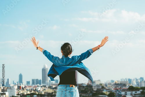 Foto auf AluDibond Licht blau Happy woman raising hands in the city scene background with copy space- feel good- relax and freedom concept