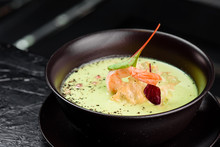 Green Cream Soup With Shrimp . Thai Food Shrimp Green Curry In A Dark Plate On A Black Background