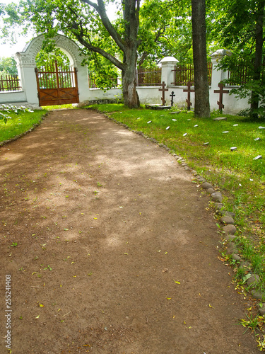 Fotografie, Obraz  Path to gate at the old brotherly cemetery
