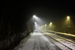 Trainstation in Winter with Snow and Fog