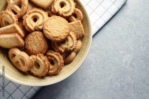Foto Bowl with Danish butter cookies on grey background, top view