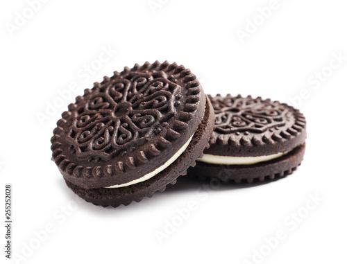 Tasty chocolate cookies with cream on white background Fototapeta