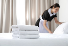 Young Maid Making Bed In Hotel...