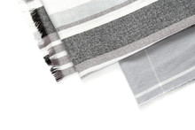 Part Of A Beautiful Gray Scarf In A Cage Isolated On A White Background With An Area For Text.
