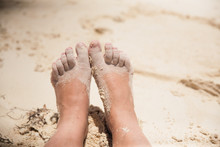 Sandy Bare Feet And Toes In The Beach Sand During The Summer