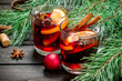 Christmas hot mulled wine with spices and aromatic herbs.