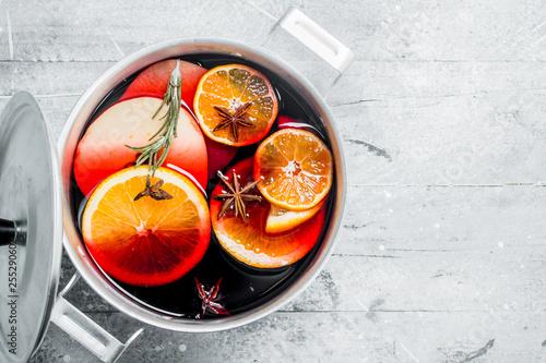 Fototapeta Hot mulled wine in a saucepan.