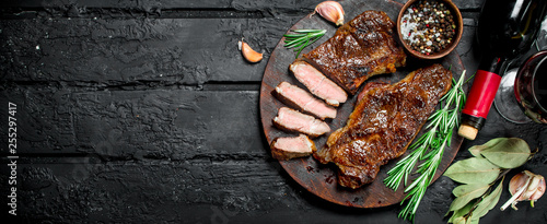 Fotografie, Obraz  Grilled beef steak with red wine.