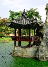 Wooden Gazebo In The Chinese G...